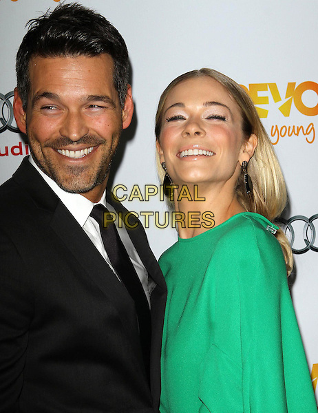 Eddie Cibrian and LeAnn Rimes.Trevor Live at The Hollywood Palladium in Hollywood, California, USA..December 4th, 2011.half length dress green side black suit stubble facial hair couple smiling   .CAP/ADM/KB.©Kevan Brooks/AdMedia/Capital Pictures.