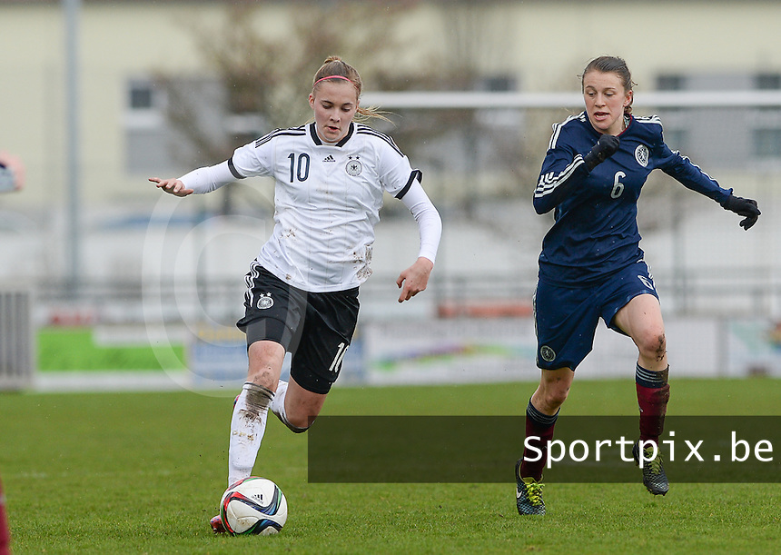 20150404 - FORST , GERMANY  : German Laura Freigang pictured in a duel with Scottish Elizabeth Arnot (right) during the soccer match between Women Under 19 teams of Germany and Scotland , on the first matchday in group 5 of the UEFA Elite Round Women Under 19 at WaldseeStadion , Forst , Germany . Saturday 4th April 2015 . PHOTO DAVID CATRY