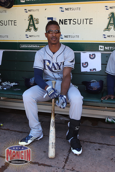 OAKLAND, CA - AUGUST 1:  B.J. Upton #2 of the Tampa Bay Rays gets ready in the dugout before the game against the Oakland Athletics at O.co Coliseum on Wednesday, August 1, 2012 in Oakland, California. Photo by Brad Mangin