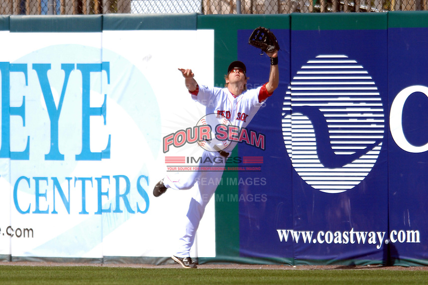 Outfielder Josh Reddick #24 of the Pawtucket Red Sox makes a leaping catch during a game versus the Buffalo Bisons on 4-17-11 at McCoy Stadium in Pawtucket, Rhode Island. Photo by Ken Babbitt /Four Seam Images
