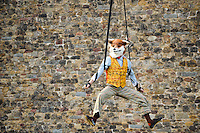 Pictured: Saturday 17 September 2016<br /> Re: Roald Dahl&rsquo;s City of the Unexpected has transformed Cardiff City Centre into a landmark celebration of Wales&rsquo; foremost storyteller, Roald Dahl, in the year which celebrates his centenary.<br /> Mr Fox performs his fantastic acrobatics outside Cardiff Castle.