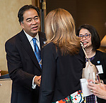 DePaul President A. Gabriel Esteban, Ph.D., and his wife Josephine meet with a group of women leaders during a reception Thursday, July 20, 2017, at The Chicago Club. The event was organized to welcome the Estebans to Chicago and introduce them to some of Chicago&rsquo;s most influential women. <br /> (DePaul University/Jamie Moncrief)