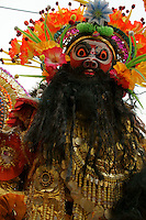 Actor with mask in a parade in the streets of Varanasi, playing a character of old Indian epos.