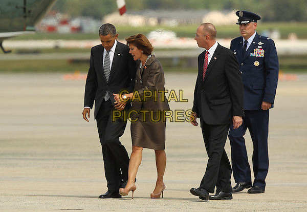 United States President Barack Obama is greeted by Colonel Michael Minihan, 89th Air Wing Commander, Joint Base Andrews, as he arrives at JBA to attend the Transfer of Remains Ceremony marking the return to the United States of the remains of the four Americans killed this week in Benghazi, Libya, at Joint Base Andrews on Friday, .September 14, 2012. .full length grey gray suit tie .CAP/ADM/CNP/MR.©Molly Riley/CNP/ADM/Capital Pictures.