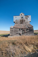 An old abandoned wooden grain elevator in the Palouse region of Washington State.