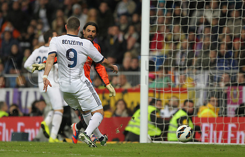 16.03.2013. Madrid, Spain.  Real Madrid's Karim Benzema scores his team's fifth goal during the Spanish Primera Division soccer match between Real Madrid and RCD Mallorca at Santiago Bernabeu stadium