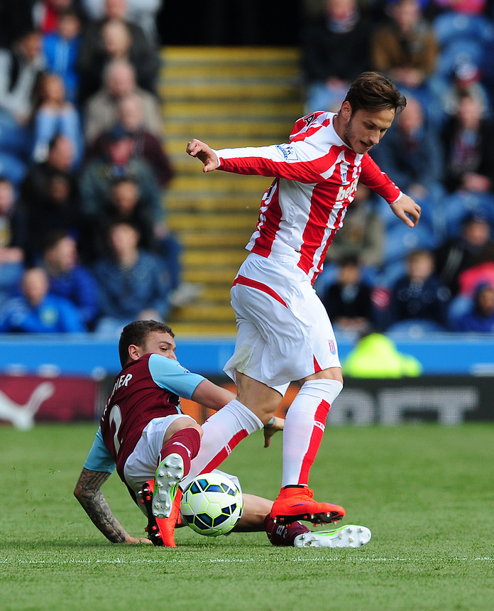 Stoke City's Marko Arnautovic is tackled by Burnley's Kieran Trippier<br /> <br /> Photographer Chris Vaughan/CameraSport<br /> <br /> Football - Barclays Premiership - Burnley v Stoke City - Saturday 16th May 2015 - Turf Moor - Burnley<br /> <br /> &copy; CameraSport - 43 Linden Ave. Countesthorpe. Leicester. England. LE8 5PG - Tel: +44 (0) 116 277 4147 - admin@camerasport.com - www.camerasport.com