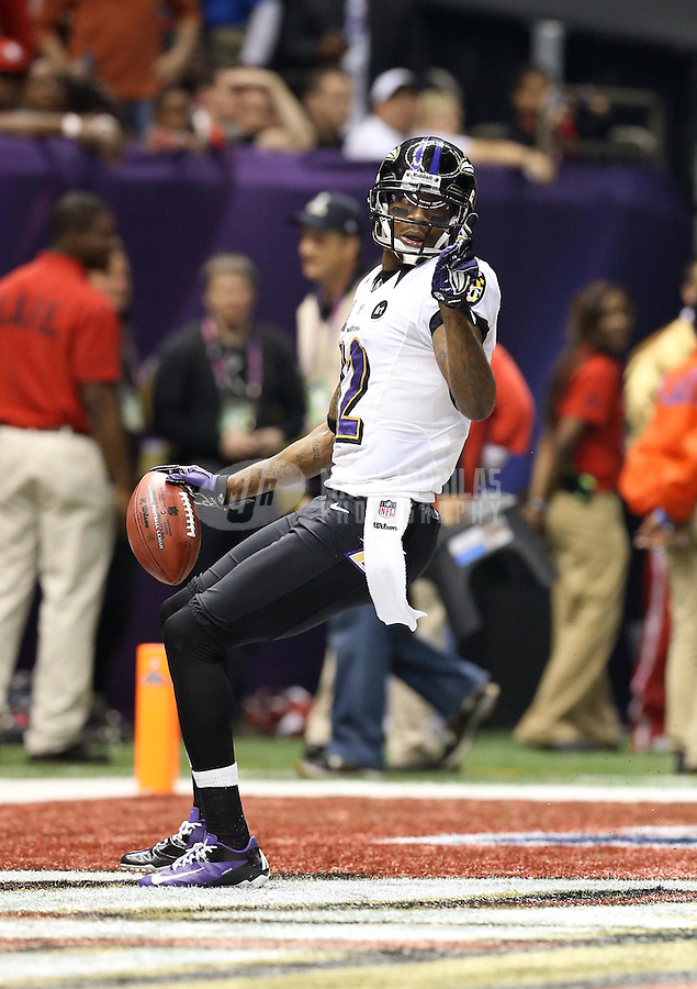 Feb 3, 2013; New Orleans, LA, USA; Baltimore Ravens wide receiver Jacoby Jones (12) reacts after scoring a touchdown on a kick return against the San Francisco 49ers in the third quarter in Super Bowl XLVII at the Mercedes-Benz Superdome. Mandatory Credit: Mark J. Rebilas-