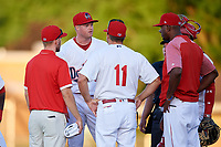 Auburn Doubledays relief pitcher Aaron Barrett (30) talks with athletic trainer Kirby Craft (left), manager Jerad Head (11), and pitching coach Franklin Bravo (right), as catcher Israel Pineda and umpire Jennifer Pawol look on, during a game against the Batavia Muckdogs on June 15, 2018 at Falcon Park in Auburn, New York.  Barrett was pulled from the game due to injury;  he has not pitched since 2015 after undergoing Tommy John surgery and fracturing his elbow in 2016.  Auburn defeated Batavia 5-1.  (Mike Janes/Four Seam Images)