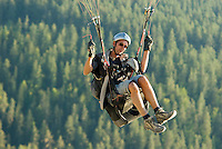 Saint Vincent-les-Forts, Lac de Serre Poncon, France, September 2007. Paragliding instructor Gijsbert Hoogerkamp takes his glider for some recreational flying.  Volantis is home to the paragliding school Inferno. In one week time, students learn to fly the paraglider and earn their mountain licence 1. Photo by Frits Meyst/Adventure4ever.com