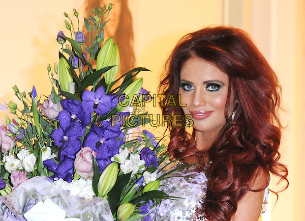 Amy Childs .Opens Her New Clothes Boutique At Eastgate Shopping Centre, Basildon, Essex, UK, 1st December 2012..portrait headshot silver sequined sequin flowers bouquet .CAP/BRC.©Ben Rector/Capital Pictures.