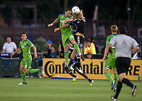 Steven Lenhart of Earthquakes battles for the ball in the air against Zach Scott of Sounders during the game at Buck Shaw Stadium in Santa Clara, California on August 11th, 2012.   Earthquakes defeated Sounders, 2-1.
