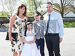 Caoimhe Kearney who received her first holy communion in St Brigid's church Dunleer pictured with parents Paul and Catriona and brother Cian. Photo:Colin Bell/pressphotos.ie