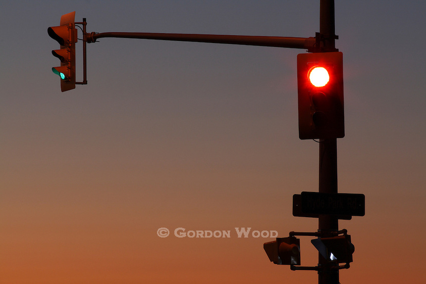 Traffic Signals at Dusk - One Green, One Red