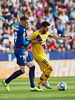 2nd November 2019; Estadi Ciutat de Valencia, Valencia, Spain; La Liga Football, Levante versus FC Barcelona; Lionel Messi of FCB holds off Carlos Clerc of Levante UD - Editorial Use