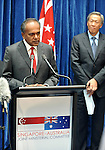 Singapore Foreign Minister K. Shanmugam, (L) is watched by Singapore Defence Minister Dr Ng Eng Hen, (R) during a press conference with their Australian counterparts at Parliament House Canberra, Monday September 10th 2012. AFP PHOTO / Mark GRAHAM