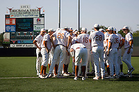 Texas Longhorns meet with coach Augie Garrido before their game against the Arizona State Sun Devils  in NCAA Tournament Super Regional Game #3 on June 12, 2011 at Disch Falk Field in Austin, Texas. (Photo by Andrew Woolley / Four Seam Images)