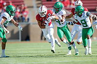 STANFORD, CA - SEPTEMBER 21: Cameron Scarlett #22 of the Stanford Cardinal runs with the ball while pursued by Thomas Graham Jr. #4 and Jevon Holland #8 of the Oregon Ducks during a game between University of Oregon and Stanford Football at Stanford Stadium on September 21, 2019 in Stanford, California.