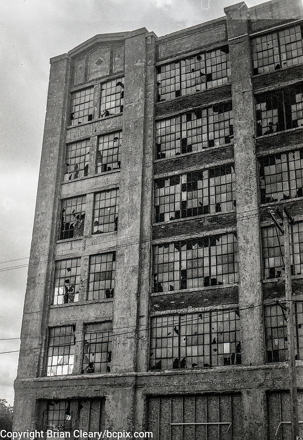 Broken warehouse windows, photo taken with 1952 vintage Kodak Signet 35, 35mm film camera on Kodak T-Max black and white film,Manitowoc, WI, July 2017.  (photo by Brian Cleary/bcpix.com)