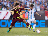 Foxborough, MA - Saturday June 18, 2016: Lionel Messi, Rolf Feltscher during a Copa America Centenario quarterfinal match between Argentina (ARG) and Venezuela (VEN)  at Gillette Stadium.