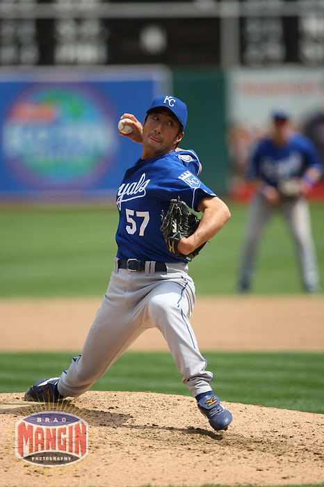 OAKLAND, CA - SEPTEMBER 2:  Yasuhiko Yabuta #57 of the Kansas City Royals pitches against the Oakland Athletics during the game at the Oakland-Alameda County Coliseum on September 2, 2009 in Oakland, California. Photo by Brad Mangin