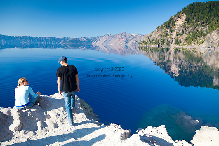 Crater Lake National Park, the only National Park in the state of Oregon, attracts some 482,000 people annualy. The lake itself is 592 meters (1,943ft) deep and is the deepest lake in the United States.  The park was founded in 1902 and seeks to preserve the natural and cultural resources.  Crater Lake lies in a caldera, or volcanic basin, created when Mt. Mazama collapsed around 7,700 years ago.  The clarity and blueness of the water are unique to this geologic area.  The lake is filled almost entirely by melted snow.  The lake is only accessibly by one trail, the Cleetwood Cove Trail, which leads down to the water for access to the tourist boats.  Boat tour on the lake.