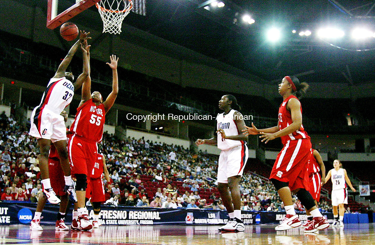FRESNO, CA. 24 March 2007-032407SV10--#32 Kalana Greene of UConn goes up for a shot as #55 Gillian Goring of NC State defends during the sweet sixteen round of the NCAA tournament at the Save Mart Center in Fresno, CA. Saturday.<br /> Steven Valenti Republican-American