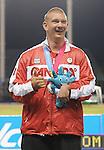 November 14 2011 - Guadalajara, Mexico:  Kevin Strybosch receiving his silver medal for F37, Discus at the 2011 Parapan American Games in Guadalajara, Mexico.  Photos: Matthew Murnaghan/Canadian Paralympic Committee