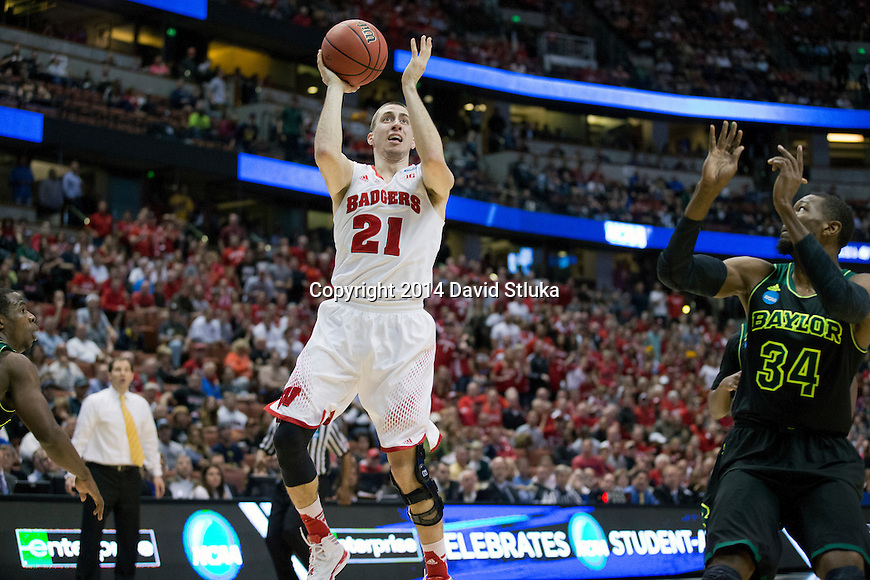 Wisconsin Badgers guard Josh Gasser (21) shoots the ball during  a regional semifinal NCAA college basketball tournament game against the Baylor Bears Thursday, March 27, 2014 in Anaheim, California. The Badgers won 69-52. (Photo by David Stluka)