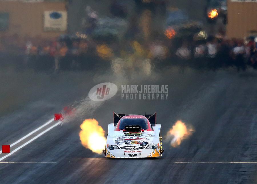 Jul. 18, 2014; Morrison, CO, USA; NHRA funny car driver Cruz Pedregon during qualifying for the Mile High Nationals at Bandimere Speedway. Mandatory Credit: Mark J. Rebilas-