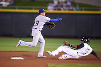 South Bend Cubs shortstop Bryant Flete (13) throws to first as Shed Long (5) slides in during a game against the Dayton Dragons on May 11, 2016 at Fifth Third Field in Dayton, Ohio.  South Bend defeated Dayton 2-0.  (Mike Janes/Four Seam Images)