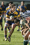 C. Stephens is picked up by Manurewa flanker R. Rawiri in a strong tackle. Counties Manukau Premier Club Rugby, Patumahoe vs Manurewa played at Patumahoe on Saturday 6th May 2006. Patumahoe won 20 - 5.