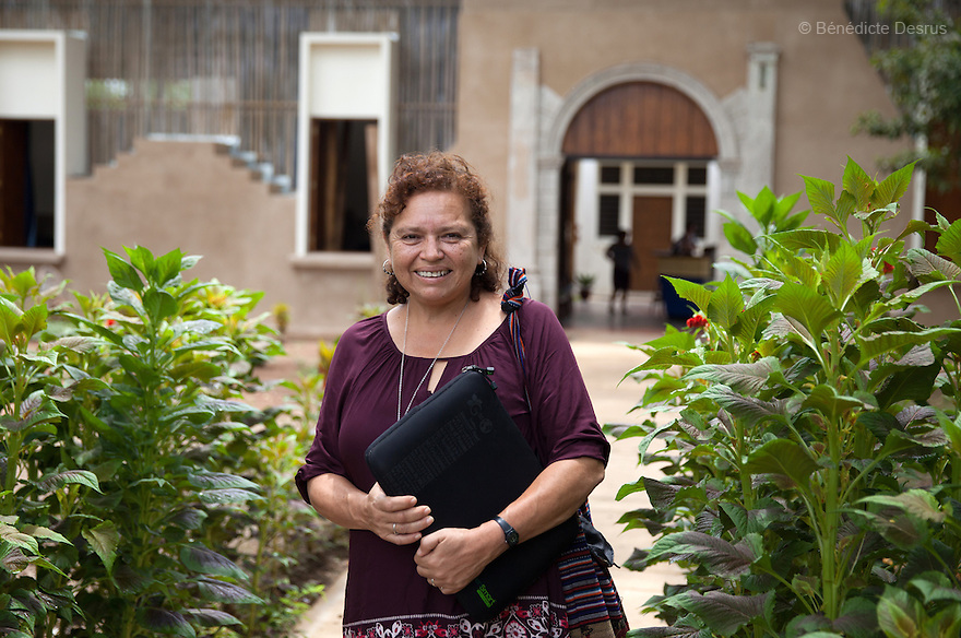 "Morena Herrera, a former Marxist guerrilla commander, now the Director of the San Salvador Feminist Collective and pro-abortion activist, in front of ""La Casa de la Mujer"" in Suchitoto, El Salvador on June 8, 2015. Abortion in El Salvador is illegal. The law formerly permitted an abortion to be performed under some limited circumstances, but, in 1998, all exceptions were removed when a new abortion law went into effect. Photo by Bénédicte Desrus"