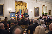 United States President Donald J. Trump makes remarks at the Congressional Medal of Honor Society Reception in the East Room of the White House in Washington, DC on Wednesday, September 12, 2018.<br /> CAP/MPI/RS<br /> &copy;RS/MPI/Capital Pictures