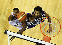 Saints import Mike Efevberha blocks Mychal Green's shot during the National Basketball League match Wellington Saints and Harbour Heat at TSB Bank Arena, Wellington, New Zealand on Saturday 13 June 2009. Photo: Dave Lintott / lintottphoto.co.nz