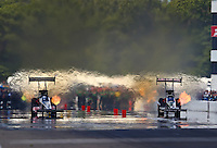 Aug. 17, 2013; Brainerd, MN, USA: NHRA top fuel dragster driver Terry McMillen (right) races alongside Bob Vandergriff Jr during qualifying for the Lucas Oil Nationals at Brainerd International Raceway. Mandatory Credit: Mark J. Rebilas-