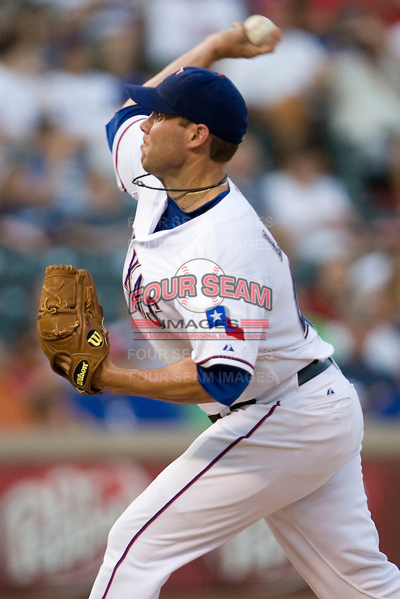 Texas Rangers starting pitcher Colby Lewis #48 delivers a pitch during the Major League Baseball game against the Texas Rangers at the Rangers Ballpark in Arlington, Texas on July 27, 2011. Lewis took the loss as Minnesota defeated Texas 7-2.  (Andrew Woolley/Four Seam Images)