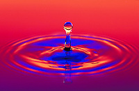Pillar result of recoil from impact of water droplet. Water frozen by strobe light. Houston Texas.