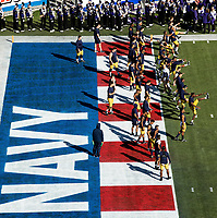 Photography of The Navy Midshipmen v. The Kansas State Wildcats during the playing of 61st Liberty Bowl at Liberty Bowl Stadium in Memphis, TN.<br /> <br /> Charlotte Photographer - PatrickSchneiderPhoto.com