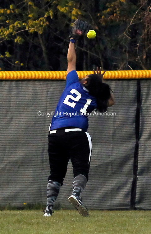 Wolcott, CT-30 April 2012-043012CM15-   Crosby's center fielder Natasha Alvarado can't get to the ball as she runs back to the wall  Monday night in Wolcott.  Christopher Massa Republican-American