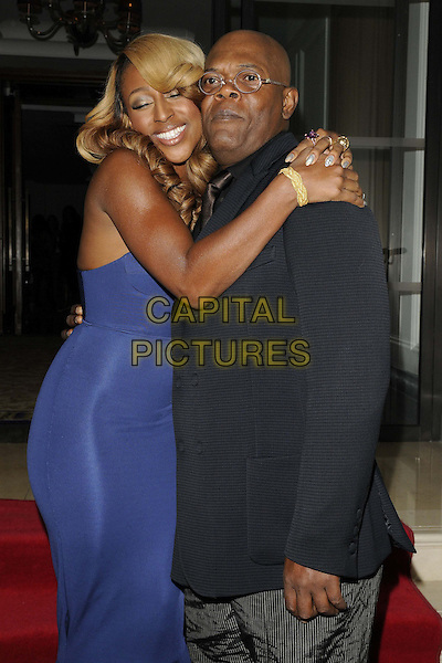 Alexandra Burke & Samuel L Jackson.attended the 'Shooting Stars Benefit' fundraising dinner & launch party, Corinthia Hotel, Whitehall Place, London, England, 20th October 2012..half length blue strapless fishtail dress hugging hug embracing arms around eyes shut smiling bustier grey gray trousers navy jacket blazer glasses .CAP/CAN.©Can Nguyen/Capital Pictures.