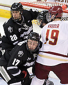 Steven Shamanski (PC - 28), Matt Bergland (PC - 17), Chris Kreider (BC - 19) - The Boston College Eagles defeated the visiting Providence College Friars 4-1 (EN) on Tuesday, December 6, 2011, at Kelley Rink in Conte Forum in Chestnut Hill, Massachusetts.