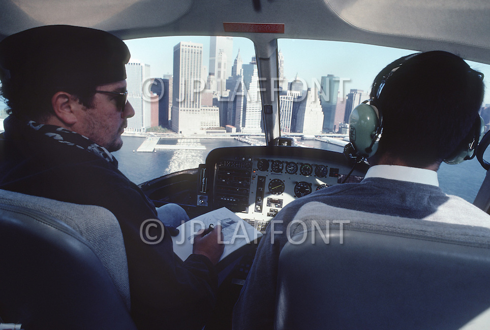 Manhattan, New York - October 6, 1988. French designer and architect Philippe Starck travels by helicopter to a construction site.