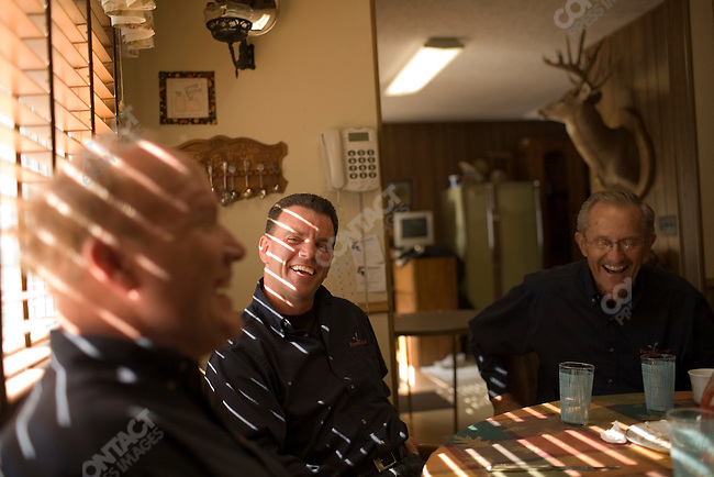 Farm Rescue founder Bill Gross enjoys a meal with Farm Rescue volunteers in  Dwayne Bring's home. Galesburg, North Dakota, October 6, 2007.