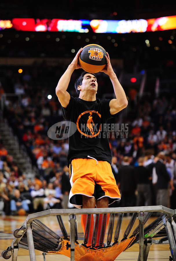 Jan. 26, 2011; Phoenix, AZ, USA; Phoenix Suns performer Nick Corrales leaps off a trampoline as he attempts to perform a dunk prior to the fourth quarter against the Charlotte Bobcats at the US Airways Center. The Bobcats defeated the Suns 114-107. Mandatory Credit: Mark J. Rebilas-
