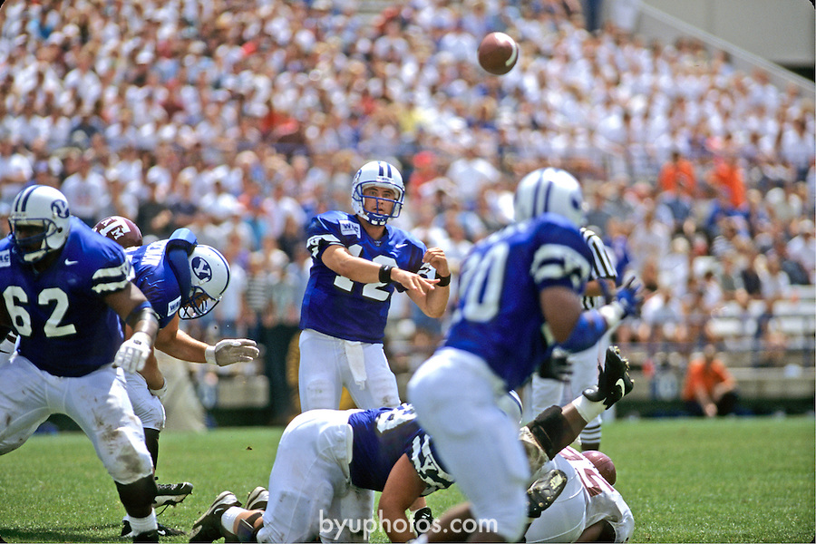 Steve Sarkisian passes for 536 yards and 6 touchdowns against Texas A&amp;M in the Pigskin Classic. 12 Steve Sarkinsian Quarterback pass. 62 Larry Moore Offensive Guard.<br /> <br /> Aug. 24, 1996<br /> FTB 9608 551<br /> <br /> Photo by Mark Philbrick/BYU