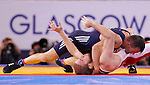 Mcc0055084 . Daily Telegraph<br /> <br /> Canada's Mike Asseltine vs Scotland's Viorel Etko in the Men's Freestyle 61kg Wrestling on Day 7 of the 2014 Commonwealth Games in Glasgow today .<br /> <br /> 30 July 2014