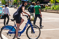 New York, NY 27 May 2013 Woman on a CitiBike pauses for a red light