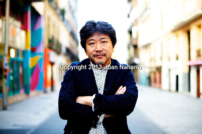 MADRID, SPAIN - NOVEMBER 22: Japanese director Hirokazu Kore-Eda poses during a portrait session during the presentation of his film 'Like Father, Like Son' (De Tal Padre, Tal Hijo) on November 22, 2013 in Madrid, Spain. (Photo by Juan Naharro Gimenez)