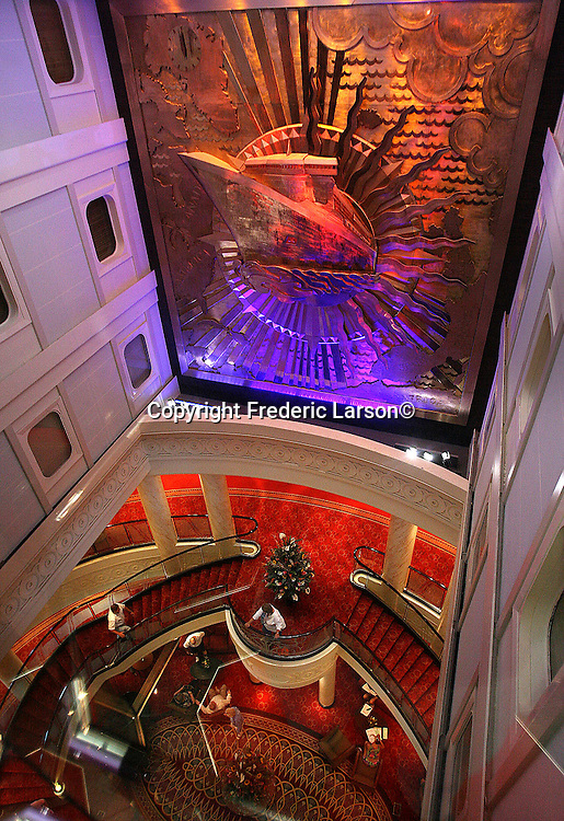 Looking below seven floors to the huge high ceiling of the grand lobby of the grandest ocean liner ever built, the Queen Mary 2 which is sailing up the coast of Mexico for San Francisco.